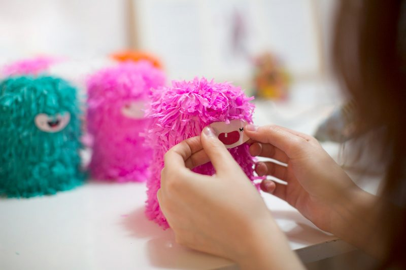Crafting a pink monster Piñata