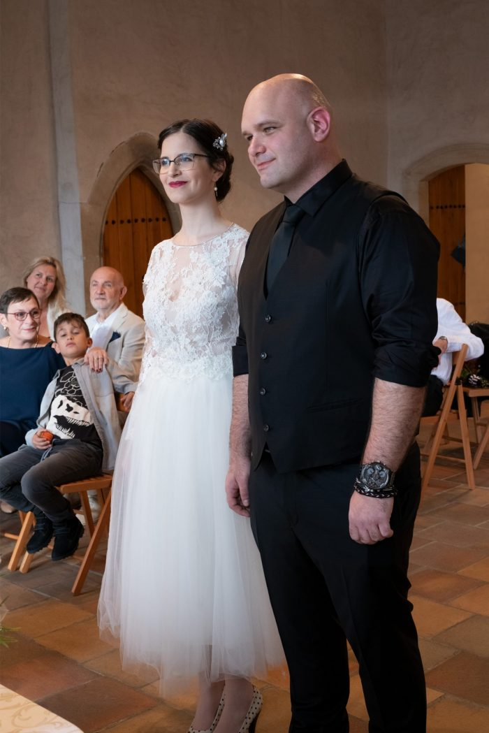 Bride in white dress and groom in black suit