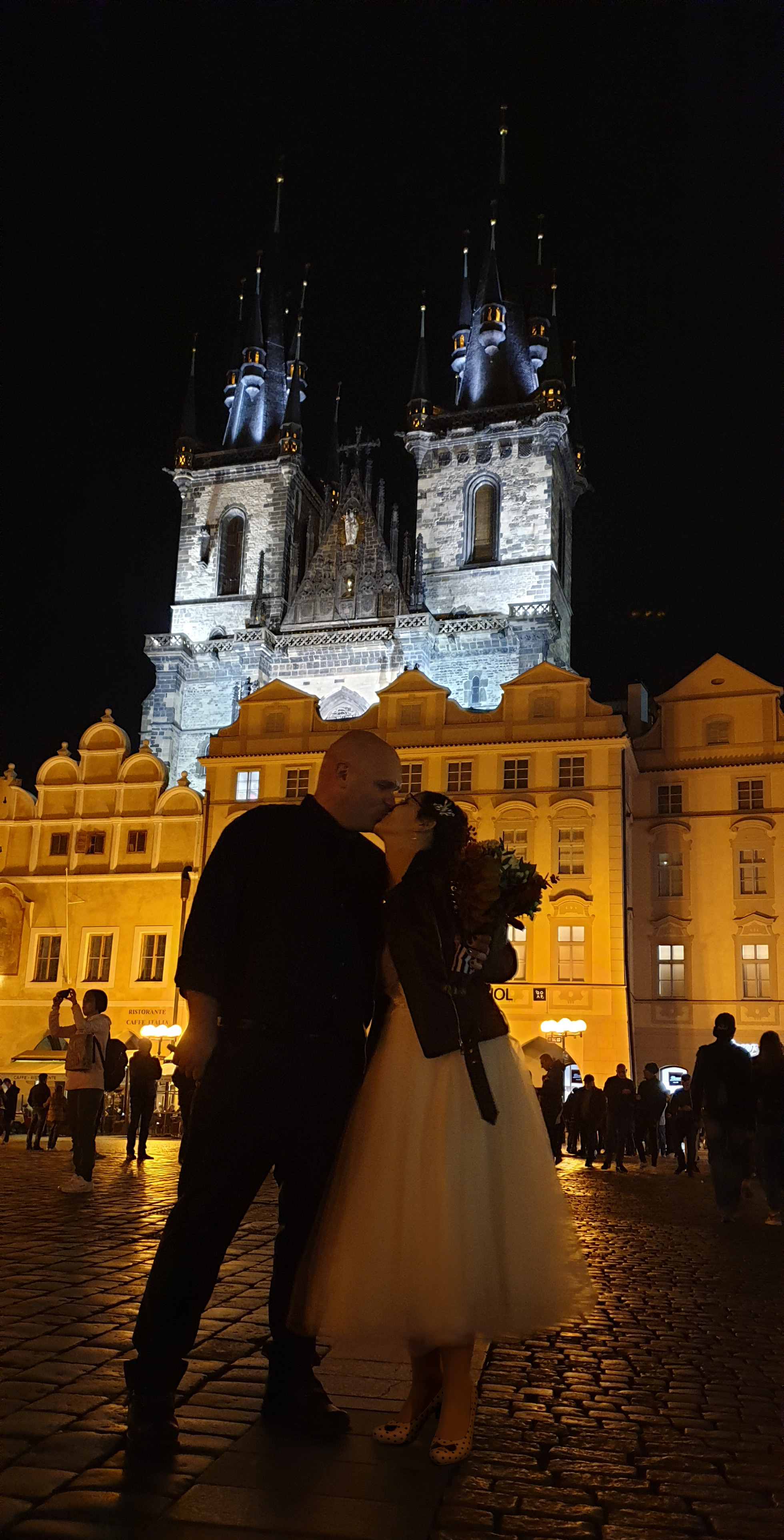 Old Town Square at night with bride and groom