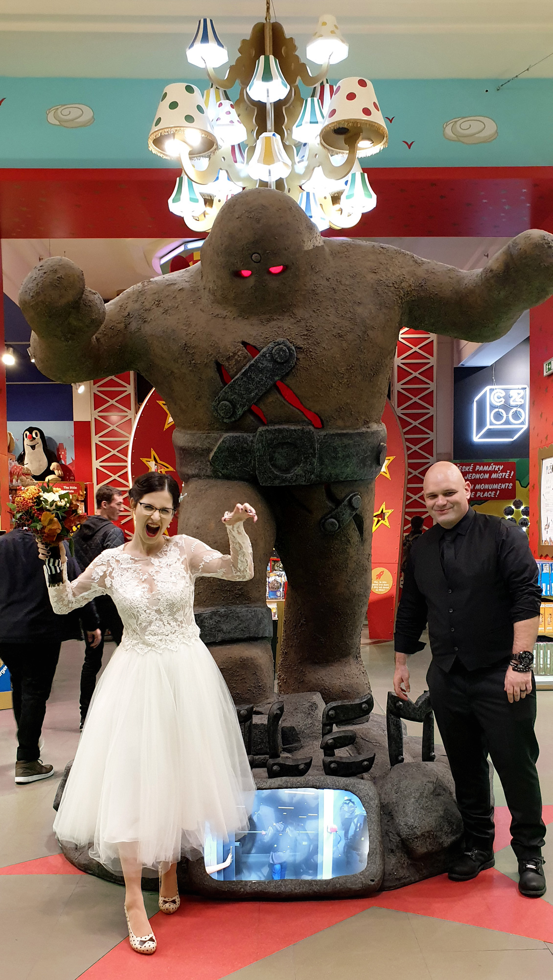 The Golem of Prague at a toy store with bride and groom