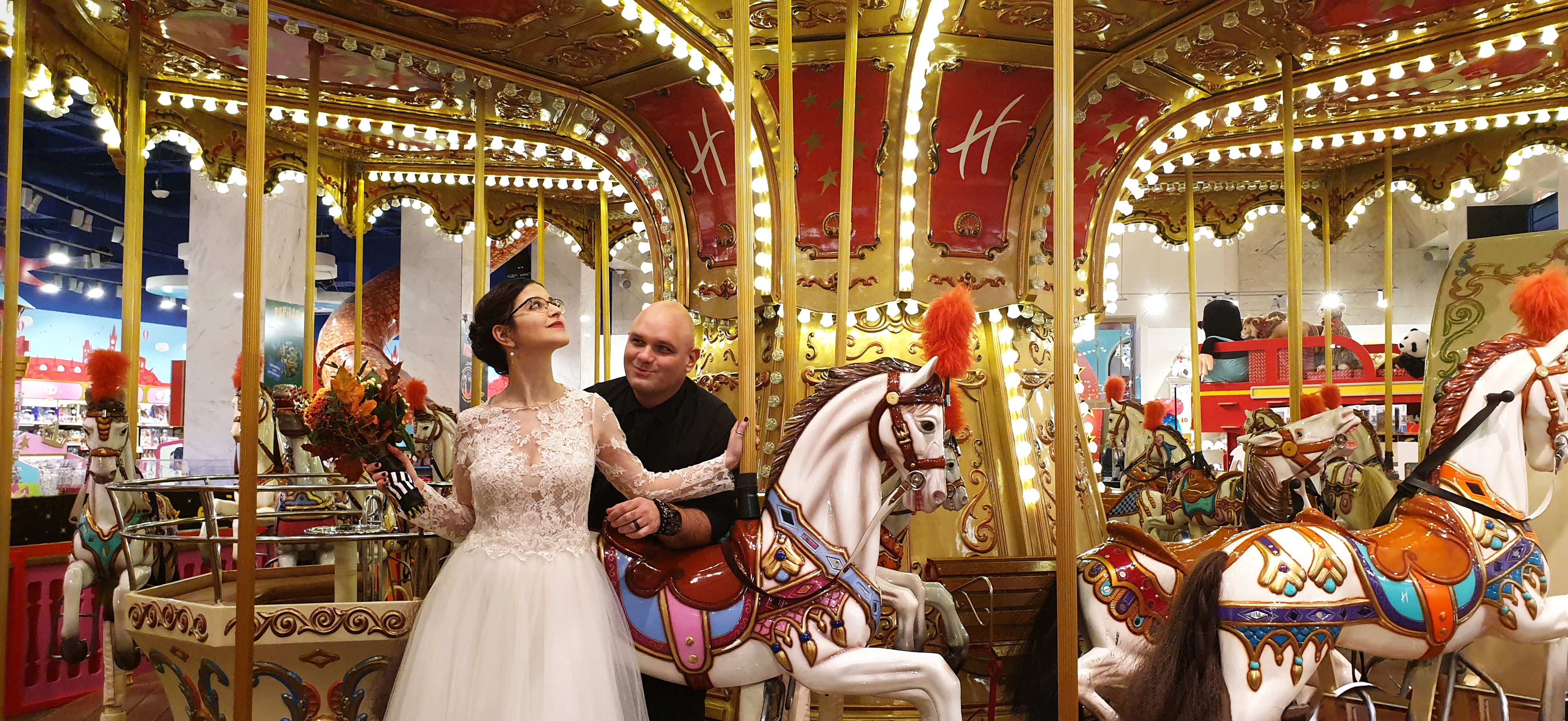 Bride and groom on a carousel