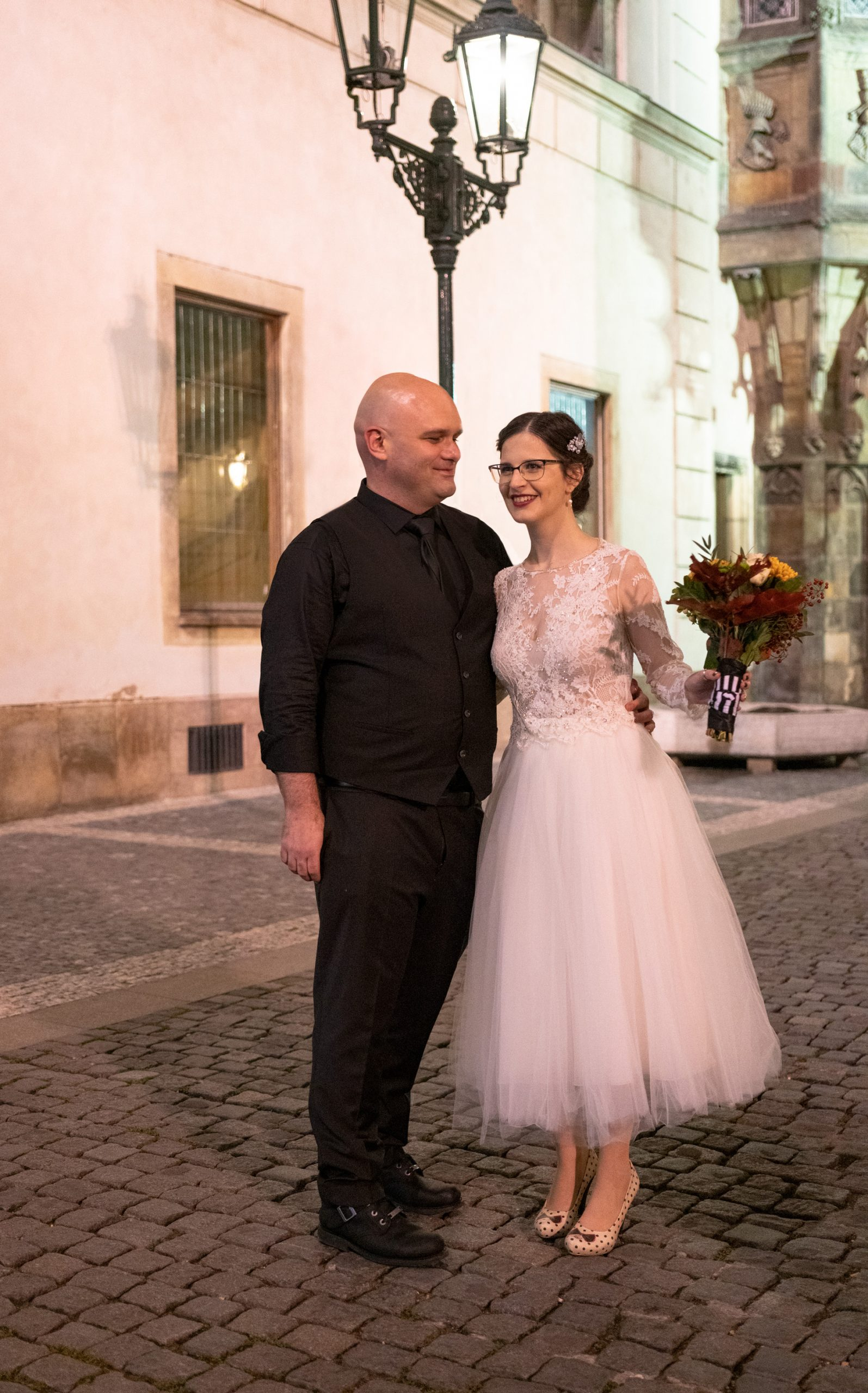 Bride with a Tulle dress by Hila Gaon and groom with a black suit