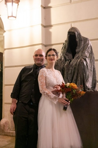 Bride and groom at night on Halloween.