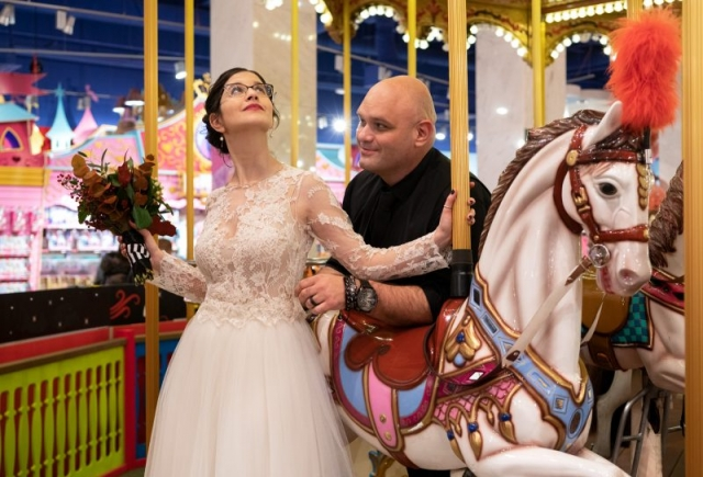 Bride and groom on a carousel horse
