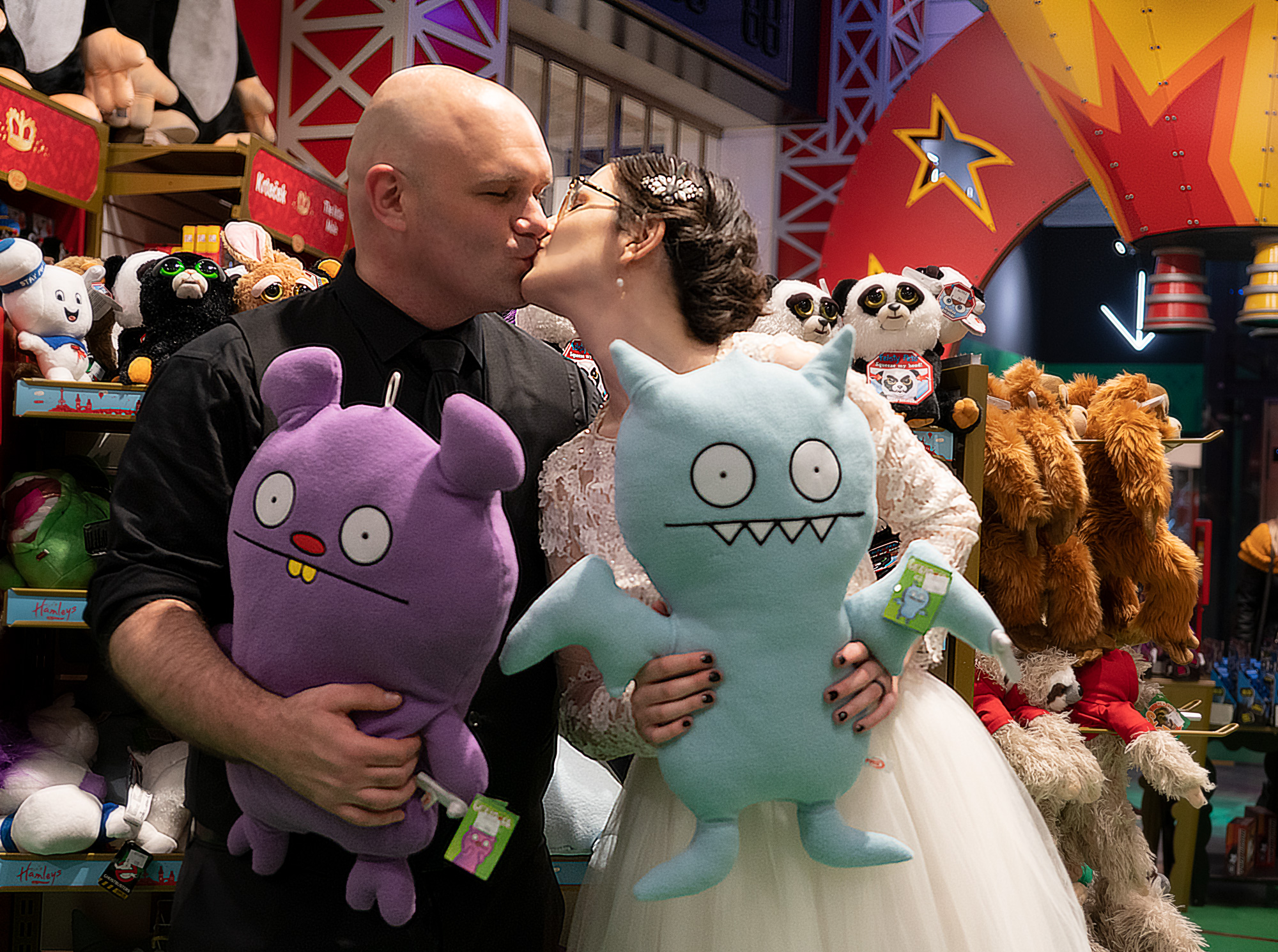 Kiss in a toy store with Uglydolls