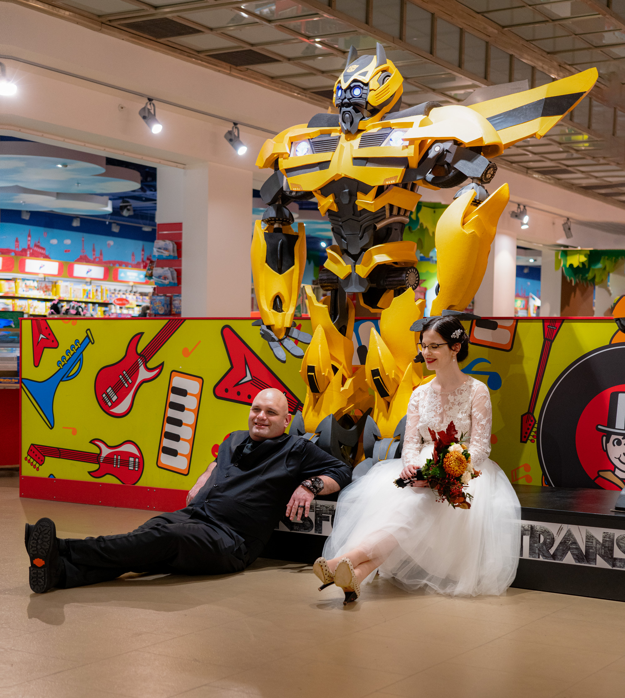 Transformer's Bumblebee at toy store with bride and groom